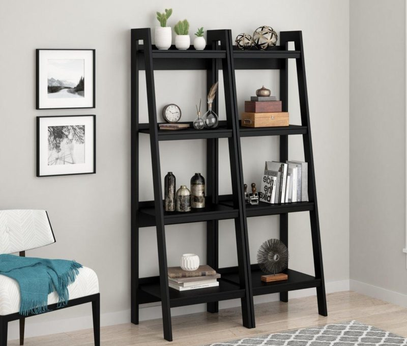 A pair of black 4-tier ladder shelves