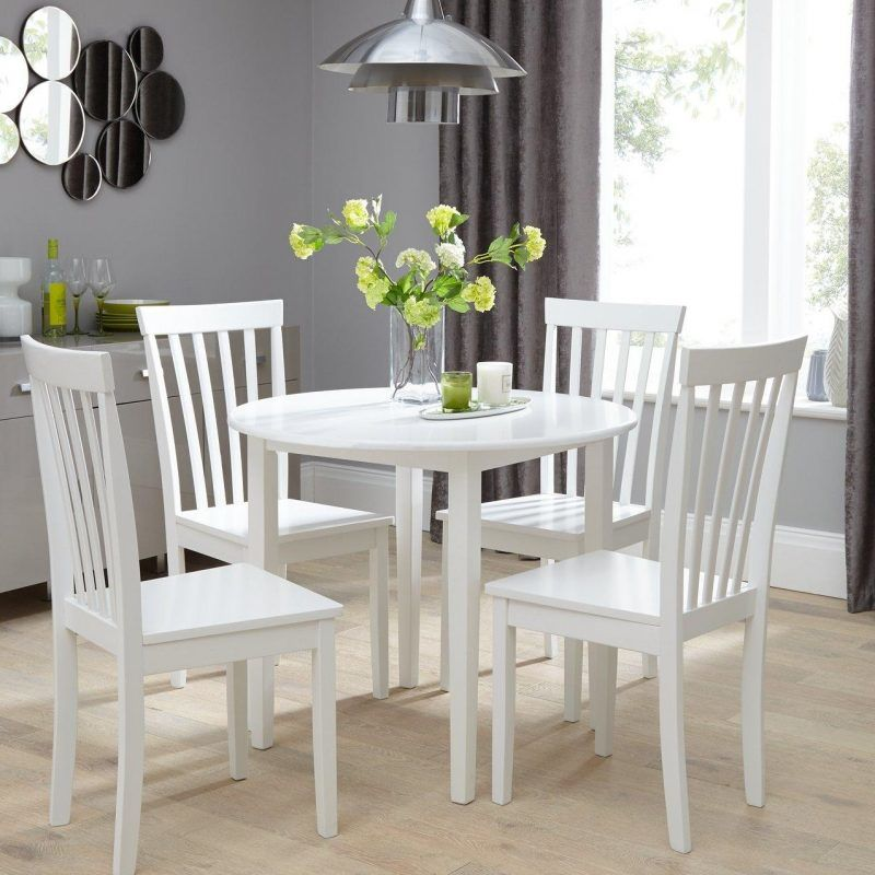 White circular dining table and 4 chairs
