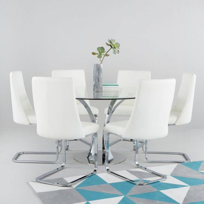 Circular glass dining table with 6 white chairs