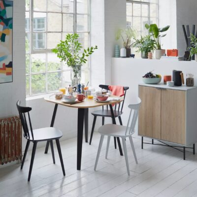 Small dining table with black legs and natural top
