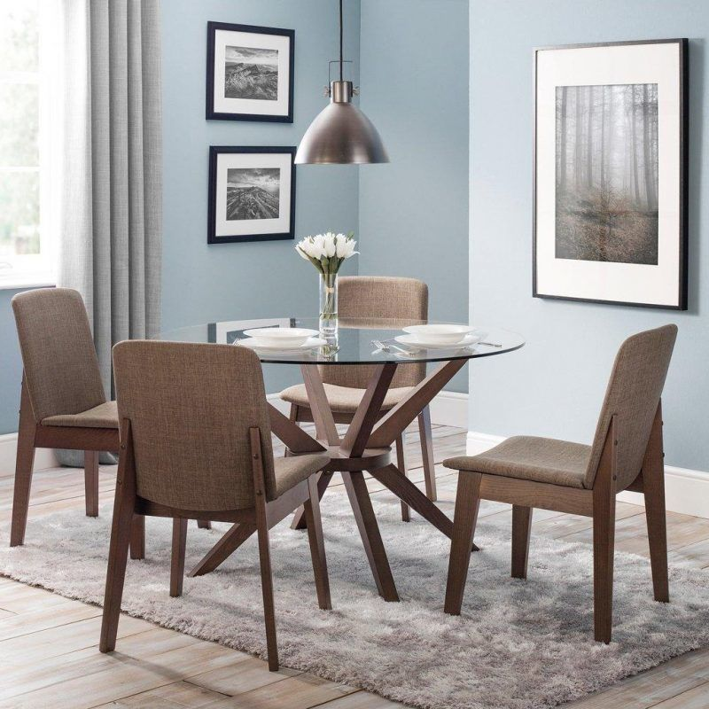 Boomerang shaped base table with glass top and 4 chairs