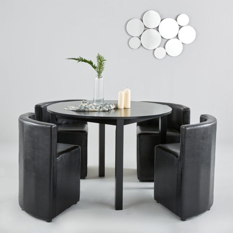 Circular dining table with 4 black chairs