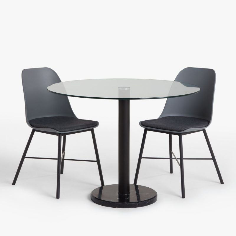 Circular glass dining table with black base