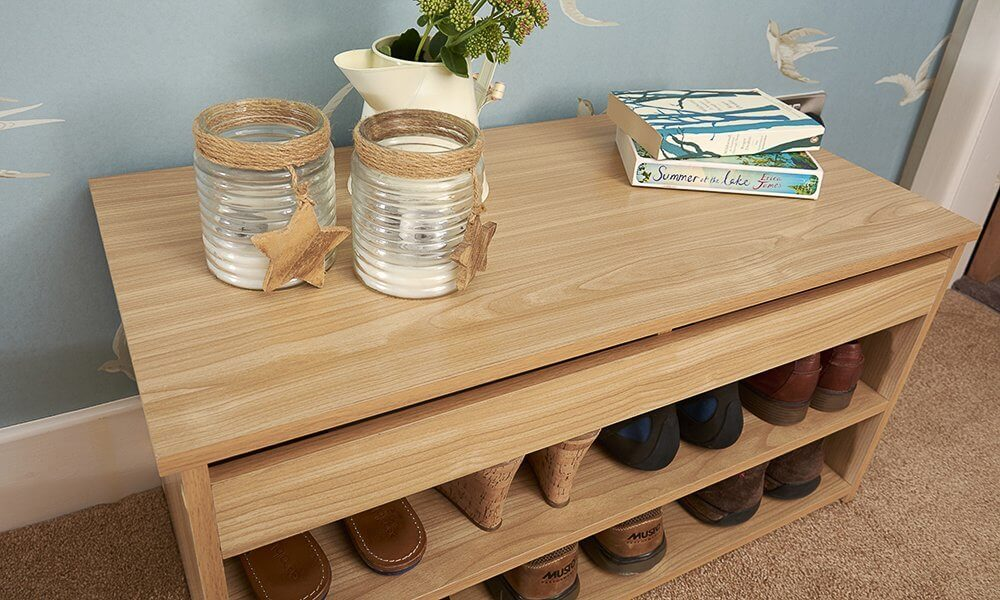 Oak coloured shoe cabinet with lift up lid