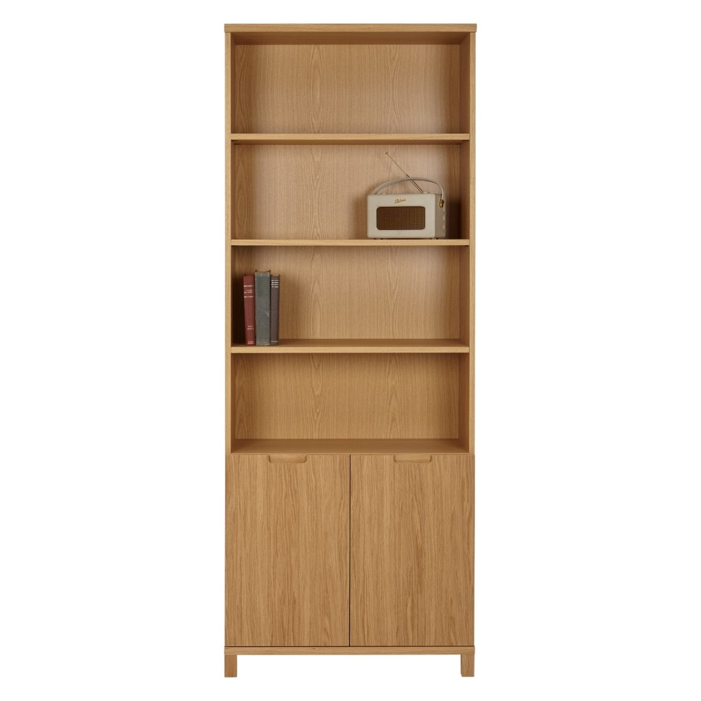Tall oak veneer bookcase with cupboard