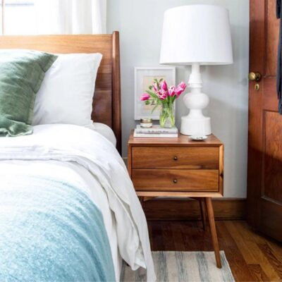Mid-century-style bedside table with acorn finish