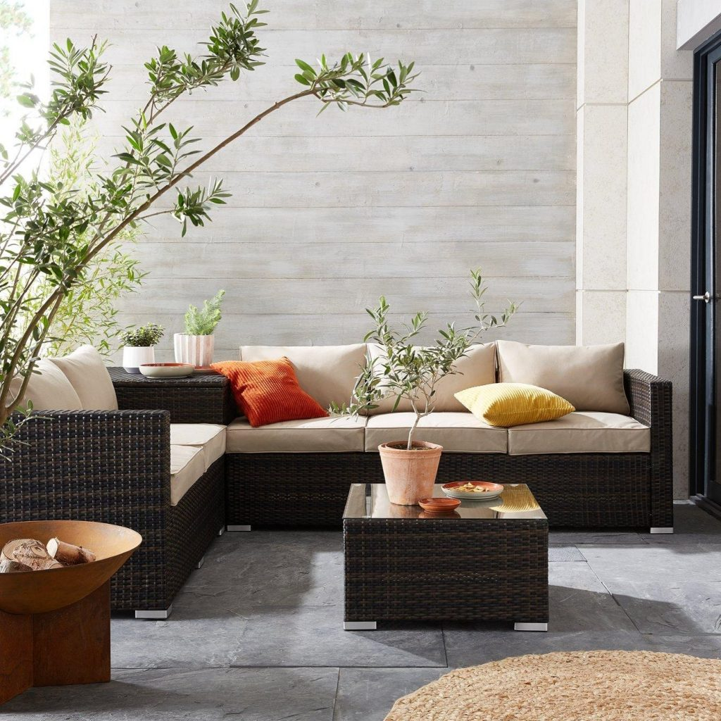 Wicker outdoor sofa set with table and storage box