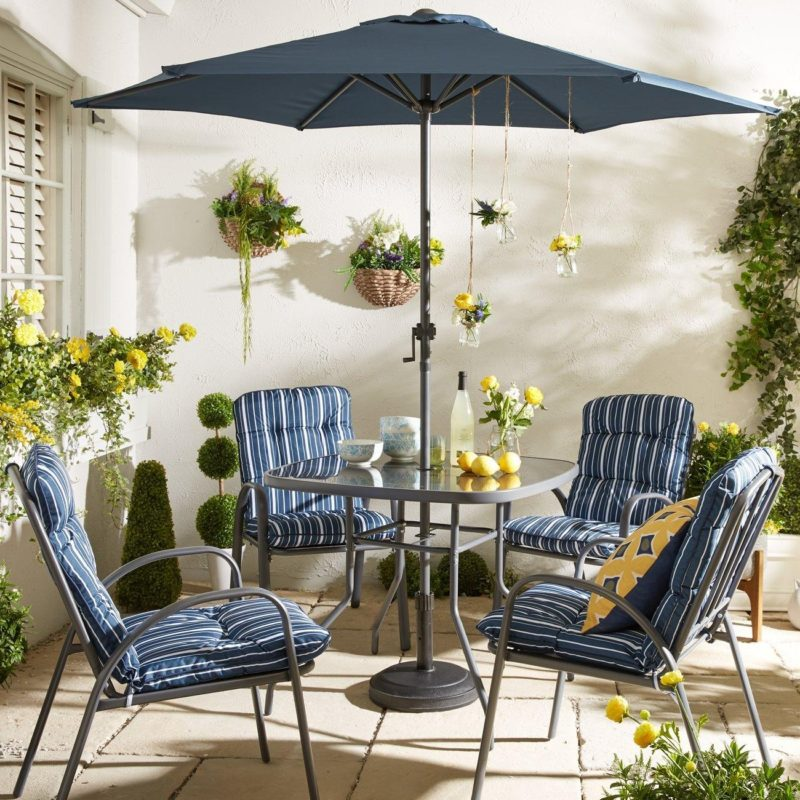 Garden dining set with blue striped cushions