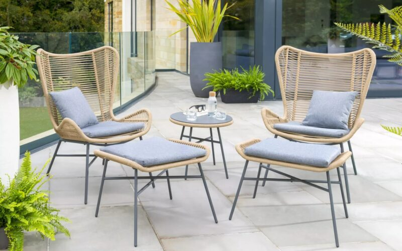 A pair of rope-weave wing back garden chairs with footstools and table