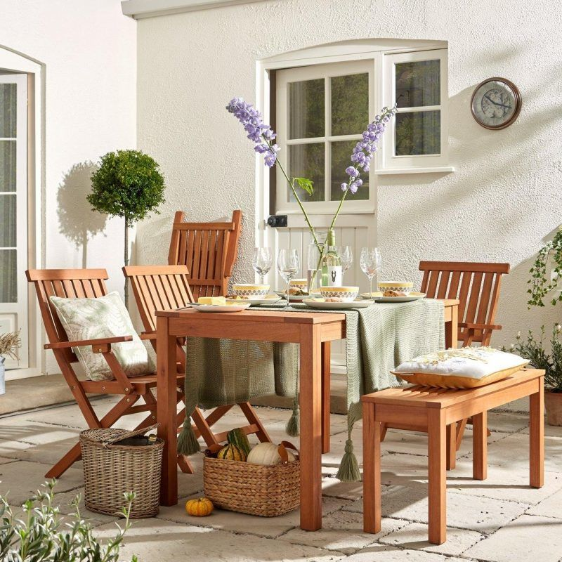 Wooden outdoor dining table with 4 chairs and a bench