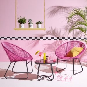 Pink circle-front chairs and table
