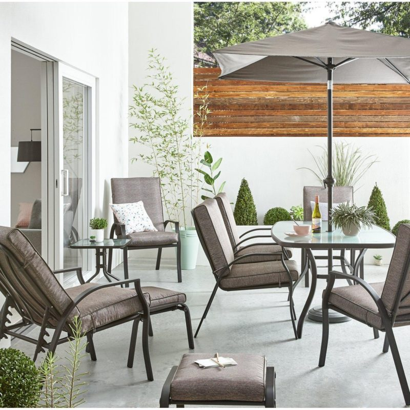 Outdoor furniture set with grey fabric covered cushioned seats