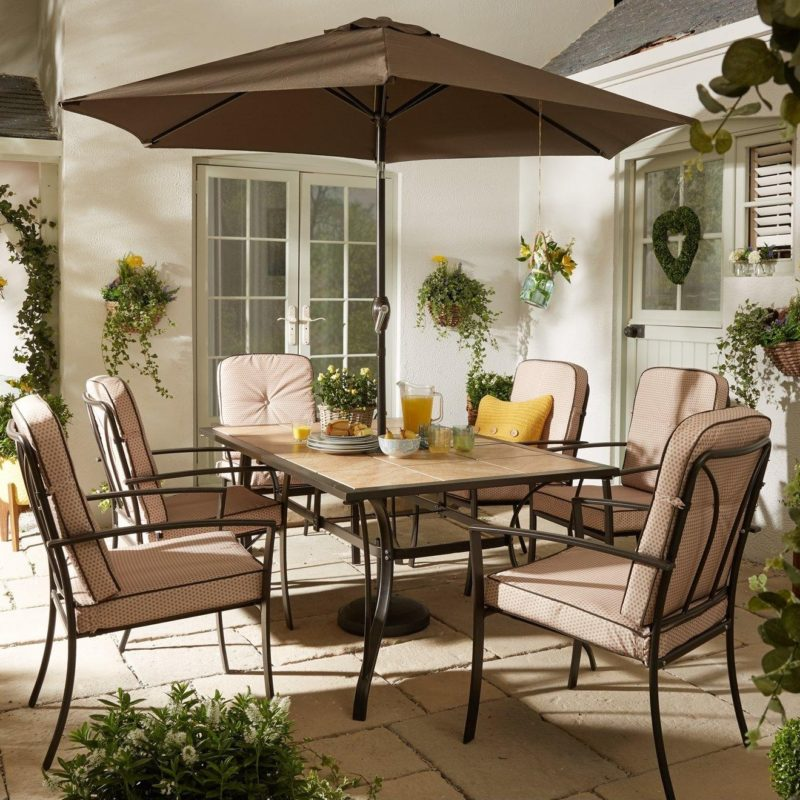 Tiled top outdoor table and 6 padded chairs