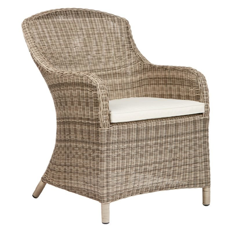 Wicker dining chair with curved back and arms
