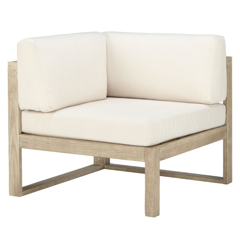 Outdoor corner chair with cream cushions