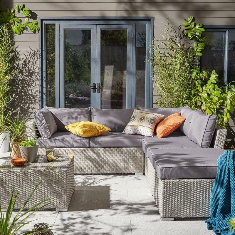 Woven wicker outdoor corner sofa and table