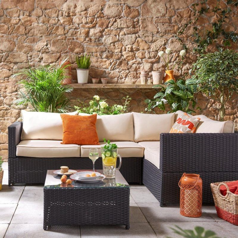 Dark rattan corner sofa and coffee table