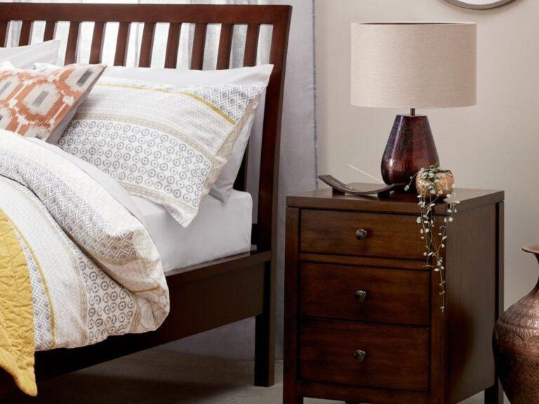 Dark wood bed frame and bedside cabinet