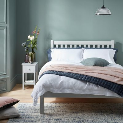 Grey painted bed frame and bedside table