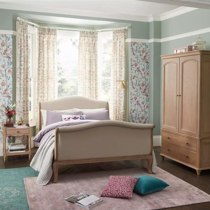 Sleigh-style bed and matching furniture