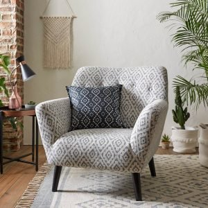 Armchair upholstered with diamond print fabric