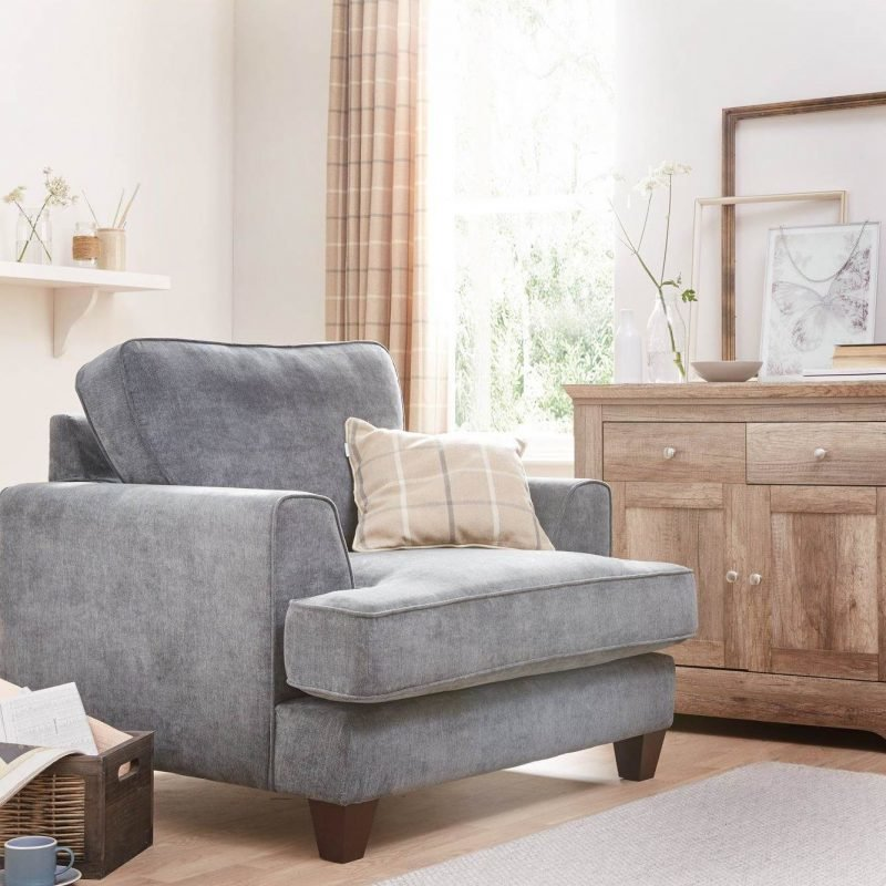 Grey fabric upholstered armchair