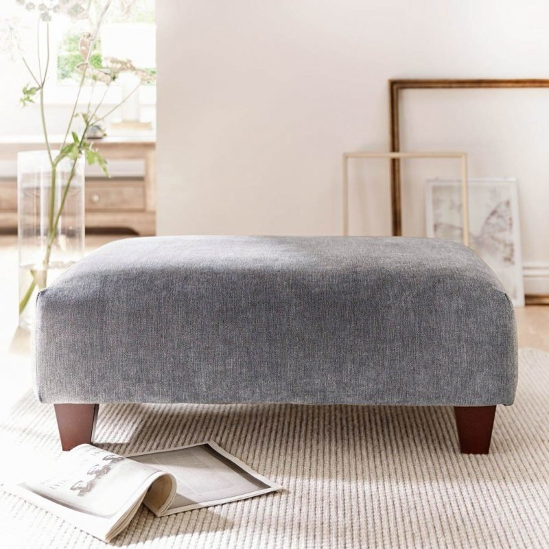 Large footstool upholstered in charcoal grey fabric