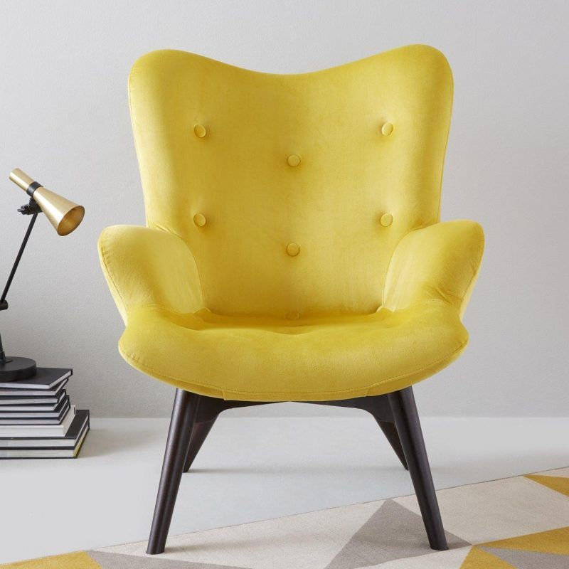 Contoured armchair upholstered in bright yellow fabric
