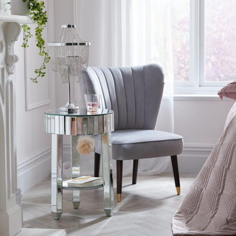 Circular bedside table with mirror finish