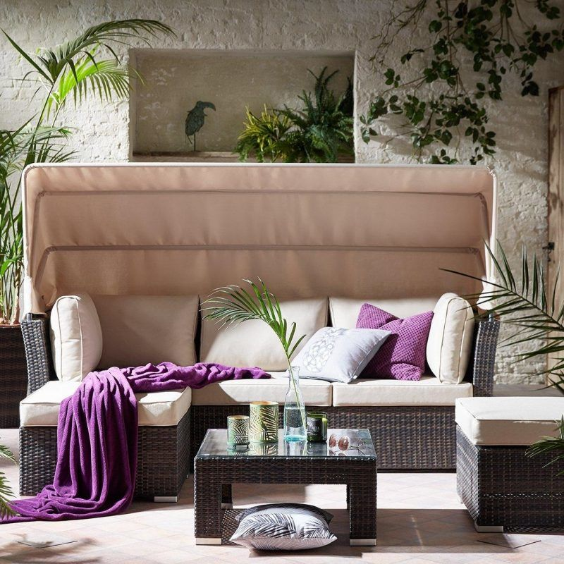 Outdoor sofa with canopy cover