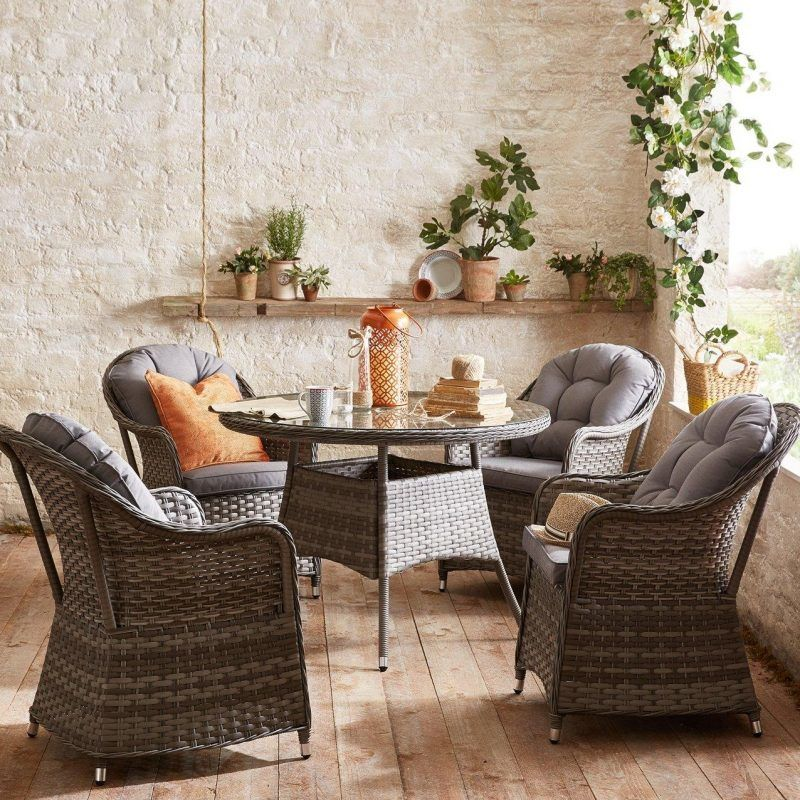 4 Rattan Dining Chairs and a Round Rattan Table