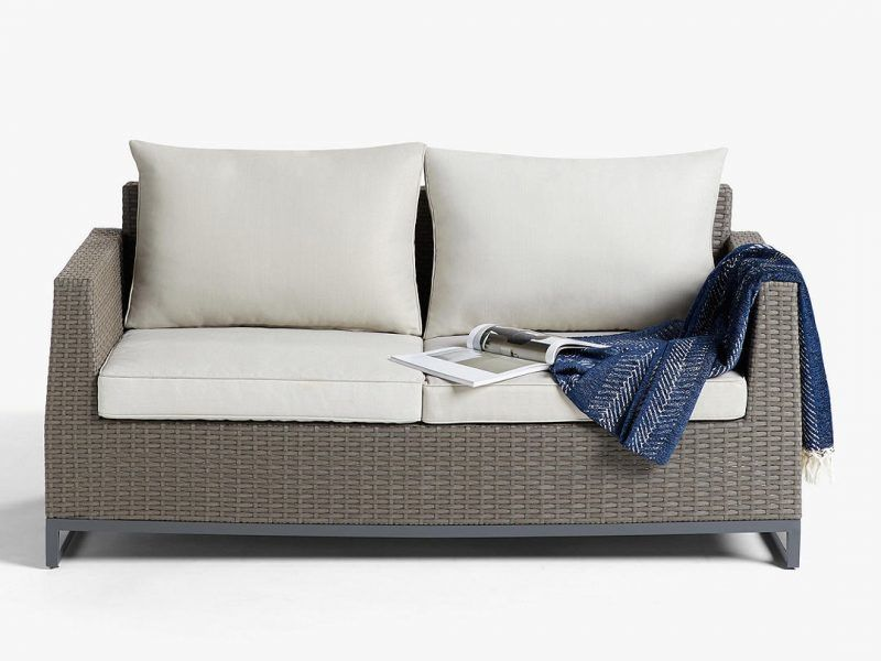 Rattan garden sofa with grey cushions