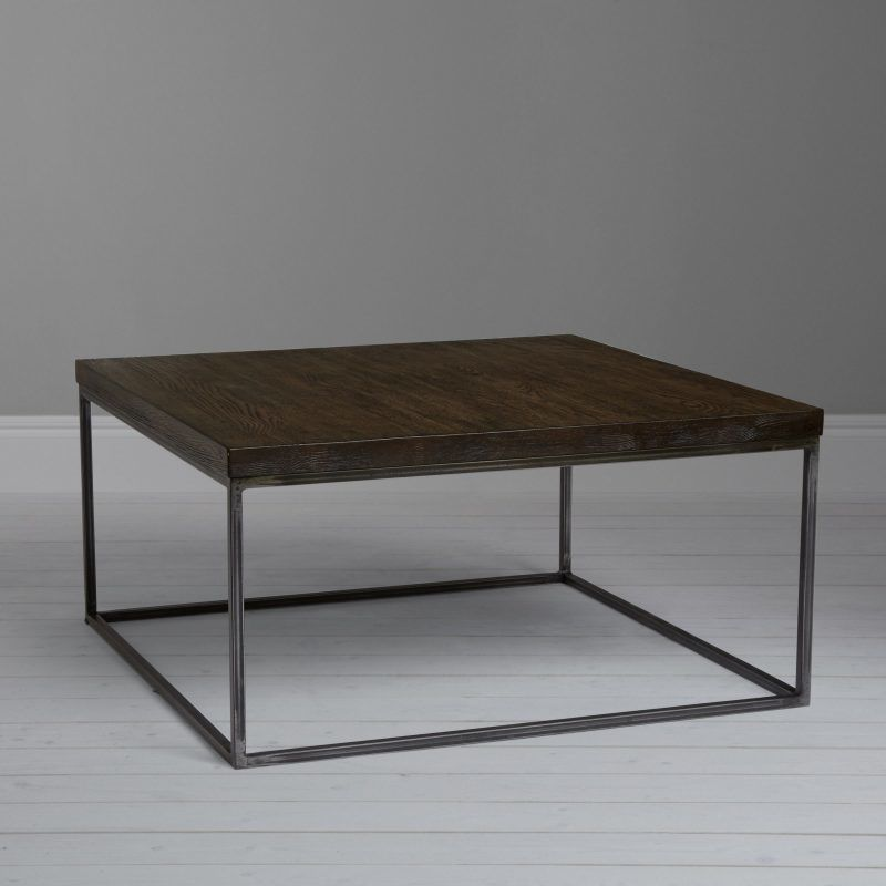 Metal framed coffee table with dark stained top