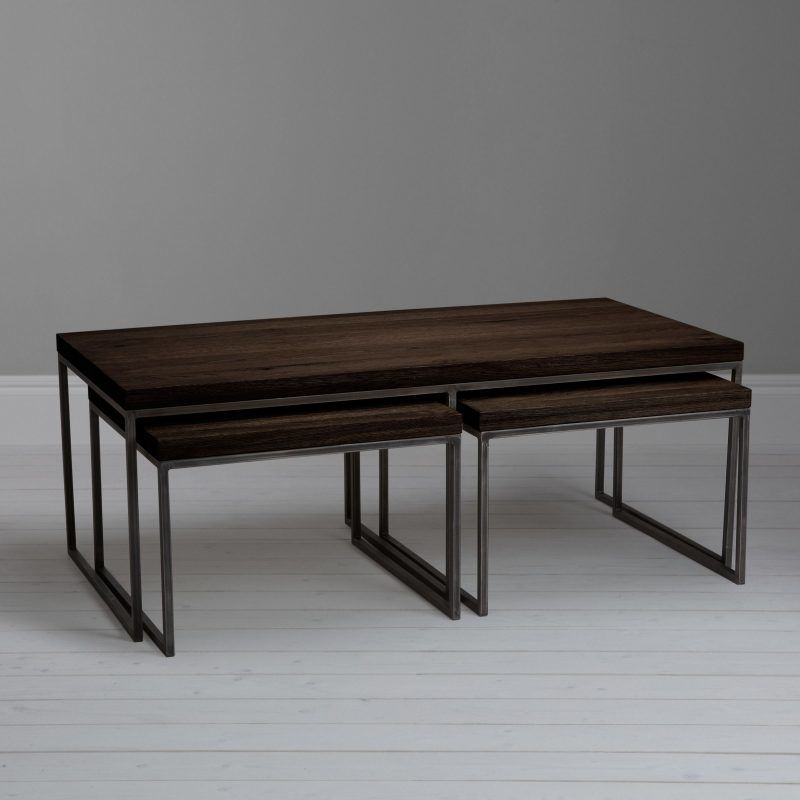 Dark oak coffee table with a pair of nesting tables