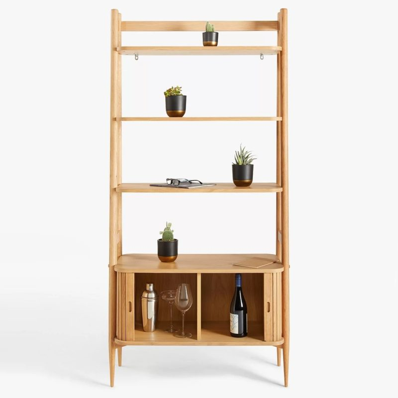 Oak shelving unit with cupboard in the base