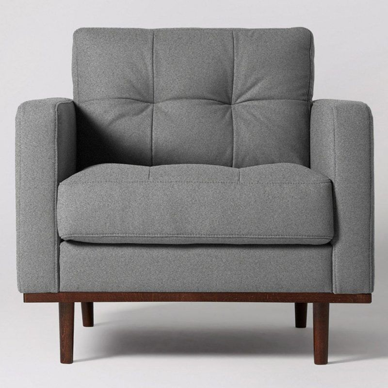 Grey fabric armchair with wood base
