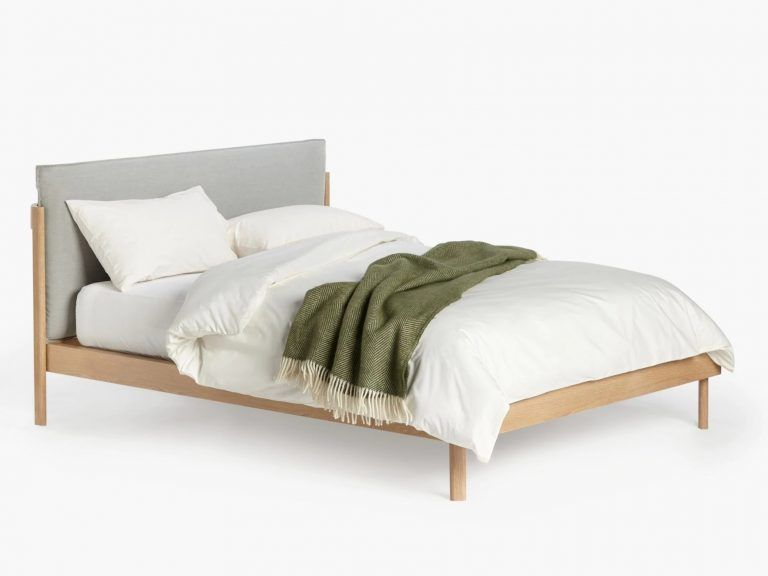 Wooden bed frame with grey pillow headboard
