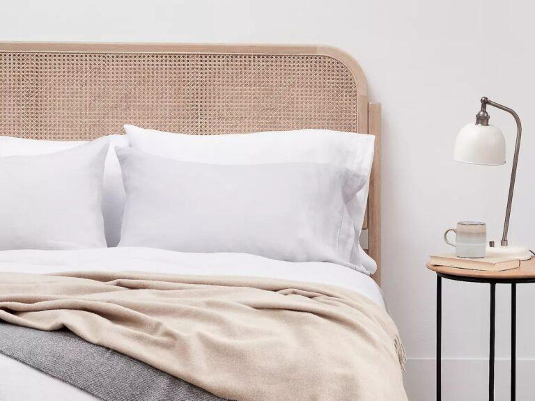 Oak bed frame with woven rattan headboard