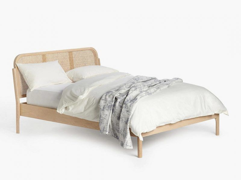 Double bed with rattan headboard