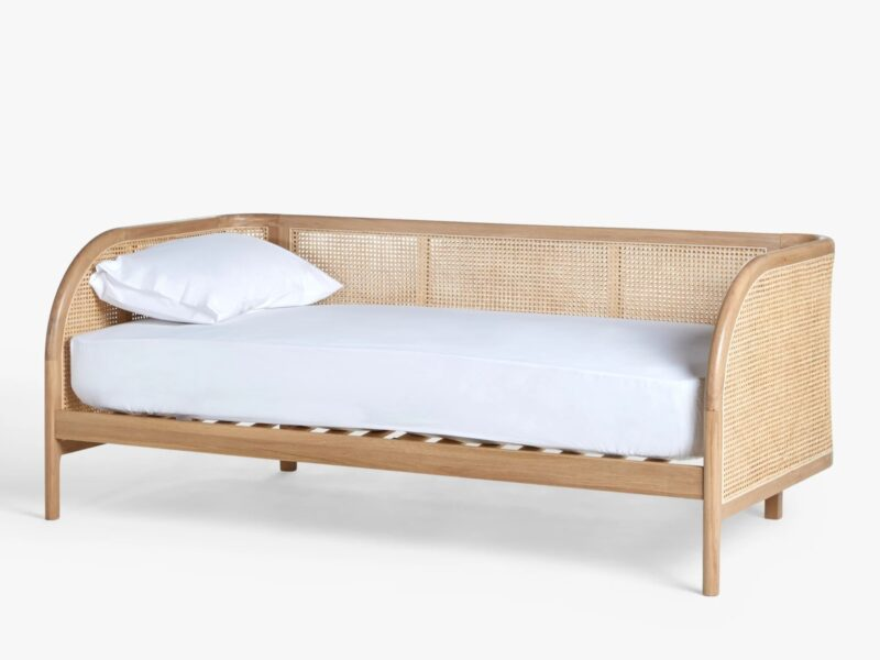Oak frame day bed with woven rattan surround