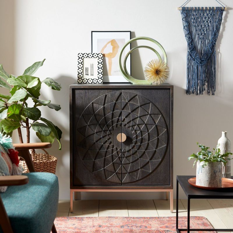 Black acacia wood cabinet with petal pattern doors