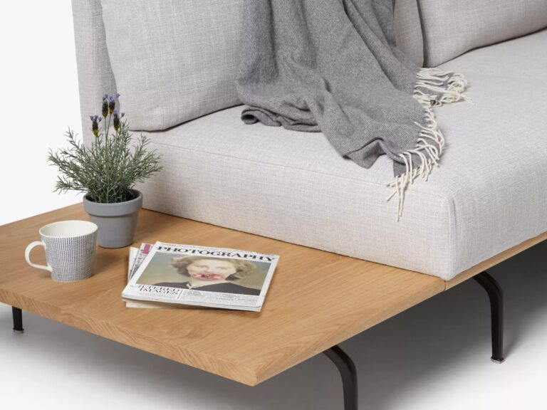 Grey fabric sofa with side table