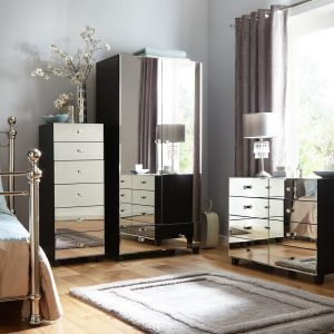 Black bedroom furniture with mirrored doors and drawers