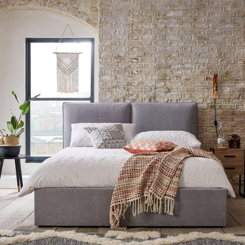 Grey fabric upholstered storage bed