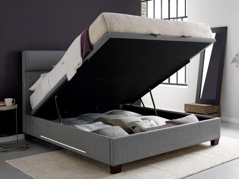 Storage bed with base lifted up
