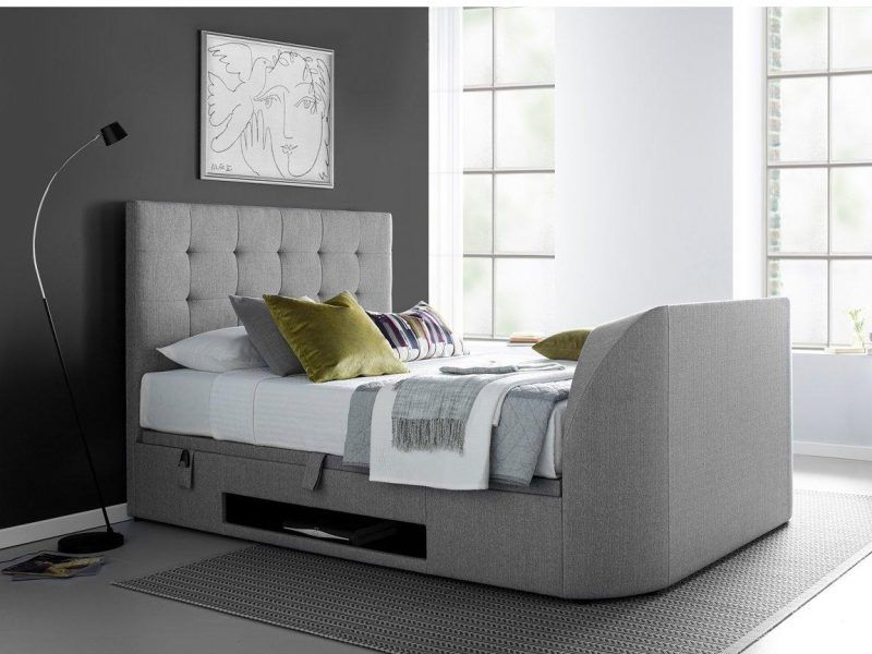 Fabric TV bed with buttoned headboard