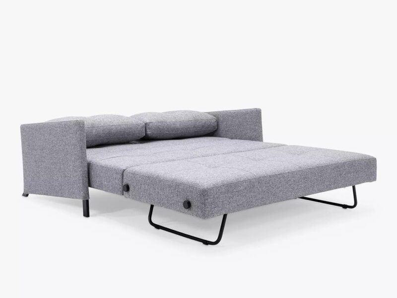 Grey fabric sofa bed laid flat