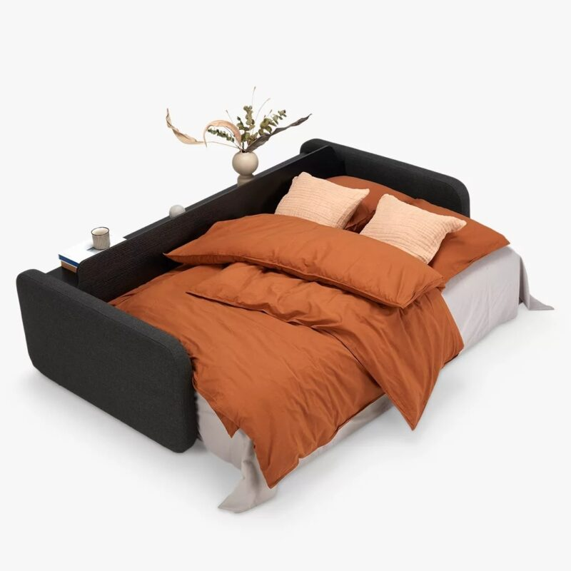 Dark fabric sofa bed made up as a bed