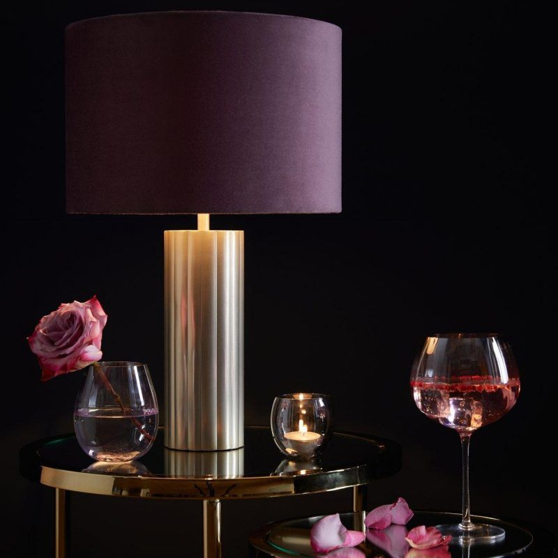 Gold coloured base lamp with deep pink shade