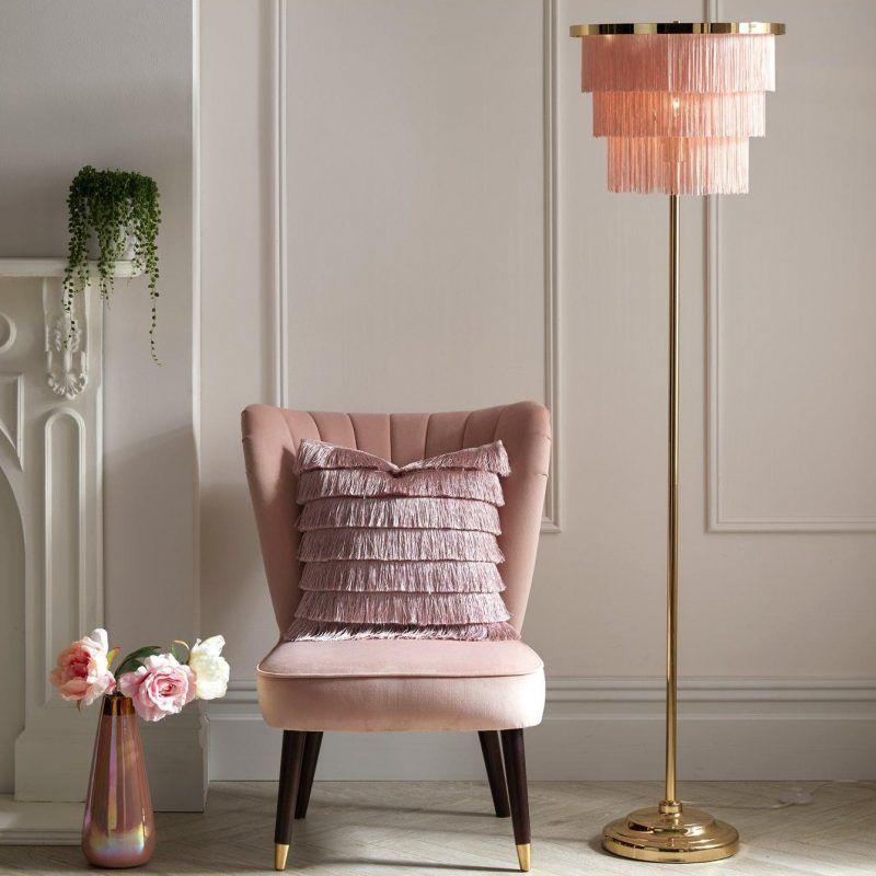 Blush pink tassel lamp, cushion and accent chair